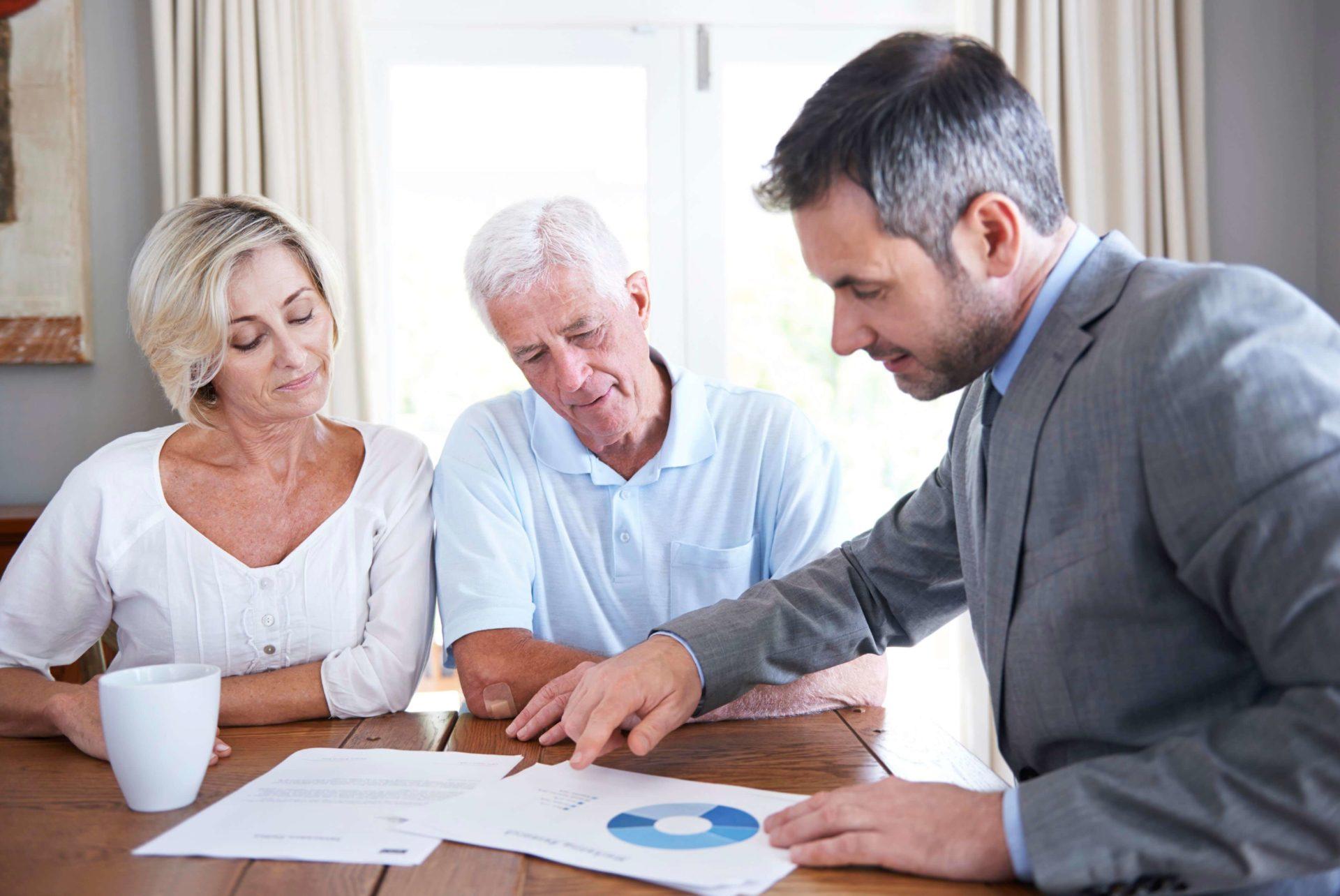 Shot of a financial advisor visiting a senior couple in their home
