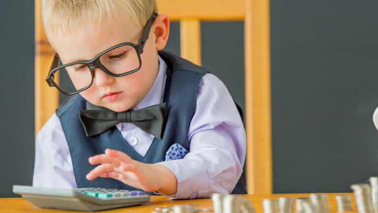 Child with Glasses adding up coins